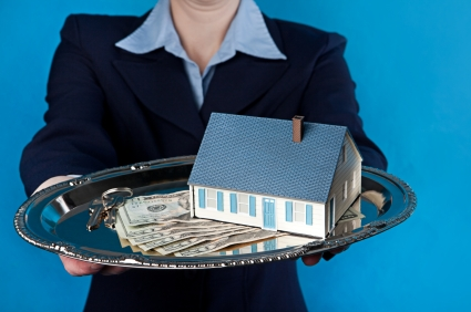 A woman holding a house with cash and keys on a silver platter.