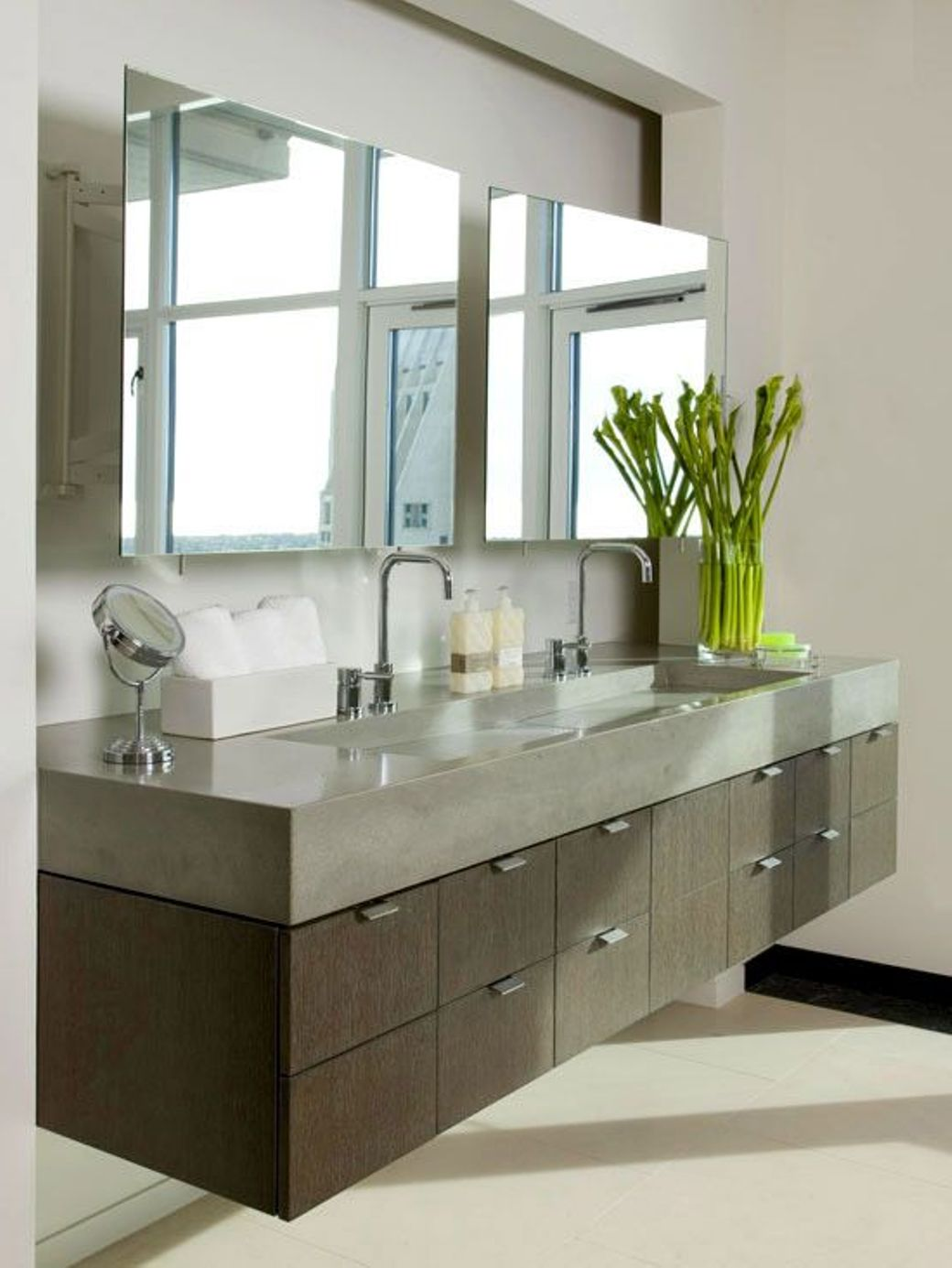 Simple Mirror Above Floating Bathroom Vanity And Fresh Flower Decor Beside Double Sink Position Realty